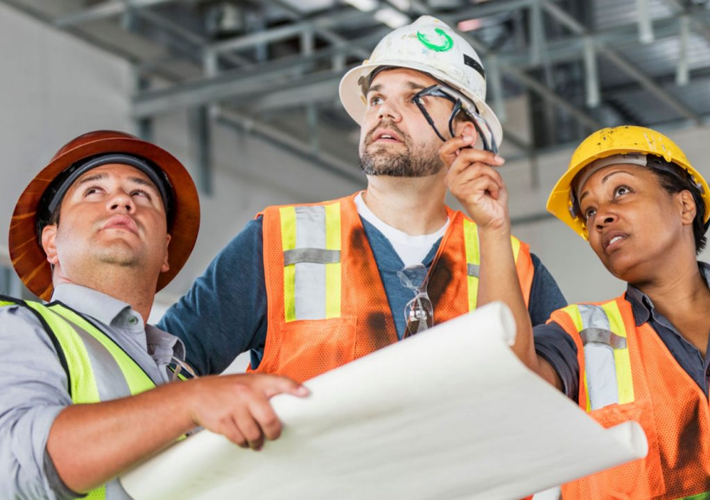 group of contractors discussing a job