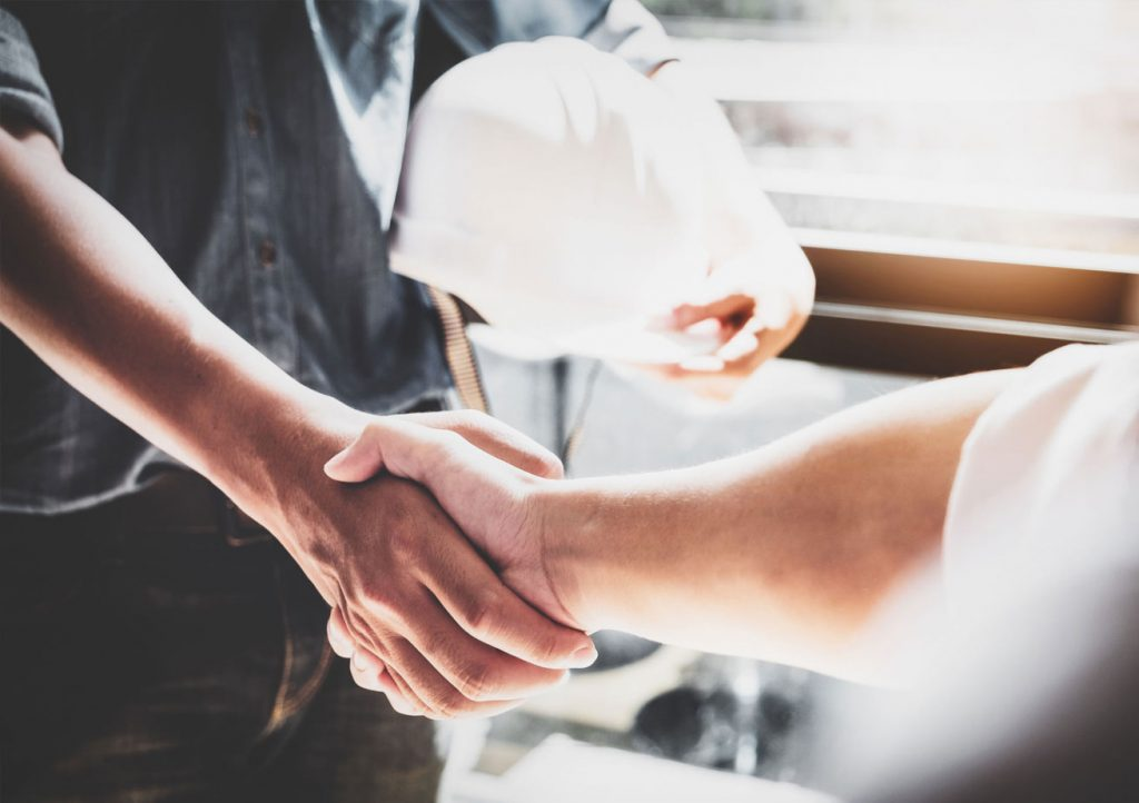 contractor shaking hands in business deal